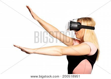 Young beautiful woman watching with VR device.