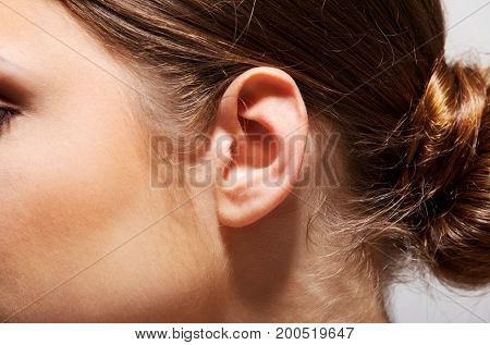 Close up of a young woman's ear.