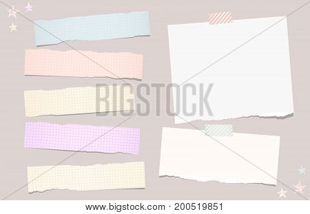 Colorful pastel, ripped, squared note, copybook, notebook paper strips stuck with sticky, adhesive tape on brown background and stars on corner
