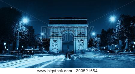 Arc de Triomphe and street view panorama at night in Paris, France.