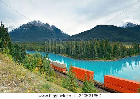 Cargo train and lake forest in Banff National Park in Canada
