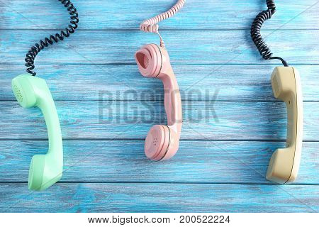 Telephone handsets on the blue wooden table
