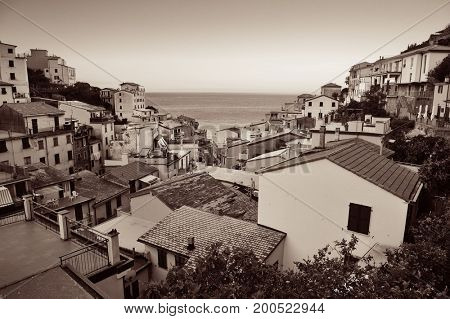 Riomaggiore waterfront view with buildings black and white in Cinque Terre, Italy.