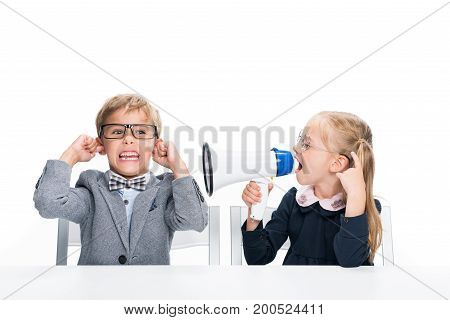Schoolgirl Shouting On Boy With Loudspeaker