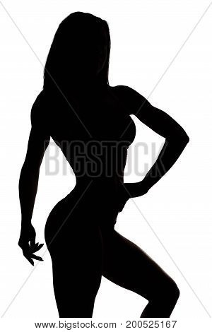 Vertical shot of a silhouette of a female bodybuilder posing isolated on white power strength confidence sports motivation gym concept.