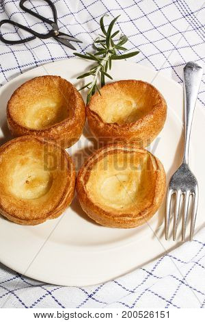 yorkshire pudding and rosemary on a plate