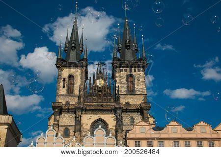Soap bubbles in front of Mother of God before Tyn church in Prague, Czech Republic