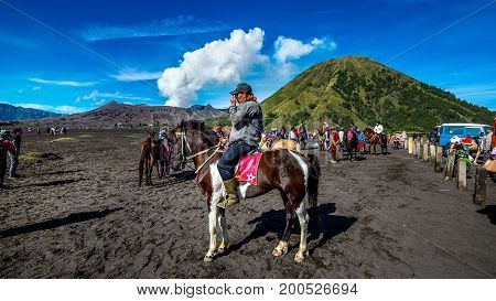 JavaIndonesia-Arpil 242017 : A horseman at Mount Bromo of Bromo-Tengger-Semeru National Park in Indonesia.