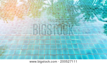 Swimming pool and reflection of coconut tree for background