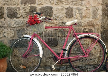 a red and pinky bike in the street