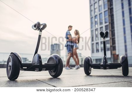 Young Couple On Gyro Scooters