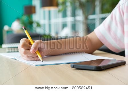 Close Up Hand Of Girl Teenager Learning Online With Mobile Phone On Wood Tabel,e-learning Education