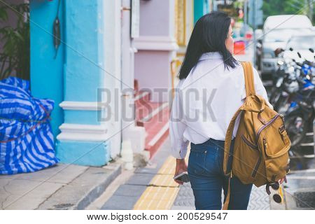 Back Of Woman Traveler Walking On Street To Sightseeing Town,city Travel Concept