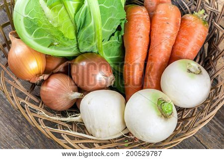 Fresh organic vegetables on wooden background, GMO free