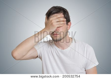 Young Disappointed Man Is Covering His Face.