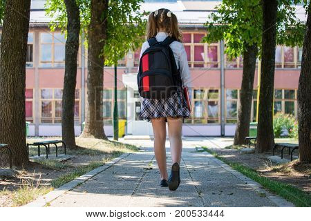 Young Blue-haired Girl With A Backpack Standing In Front Of School, Beginning Of School Year, Unifor