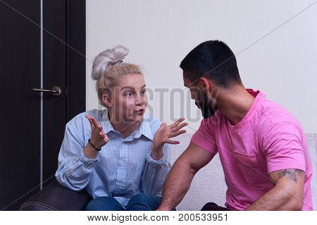 Portrait of angry couple shouting to each other. Young man and woman having relations problems.