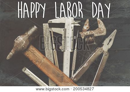 Happy Labor Day Text Sign. Tools For Repairing And Renovation Concept On Black Background Top View.