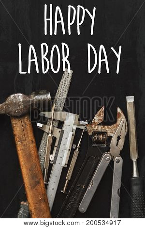 Happy Labor Day Text Sign. Working Tools On Black Background Top View. Instruments Set For Hand Work