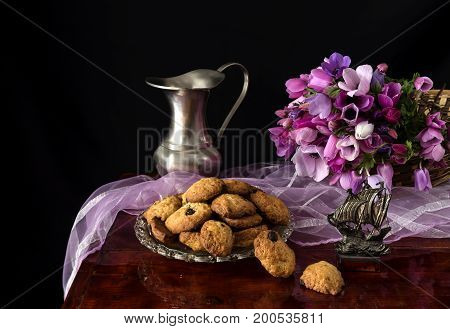 Still life with wild anemones and homemade cookies on a table close-up