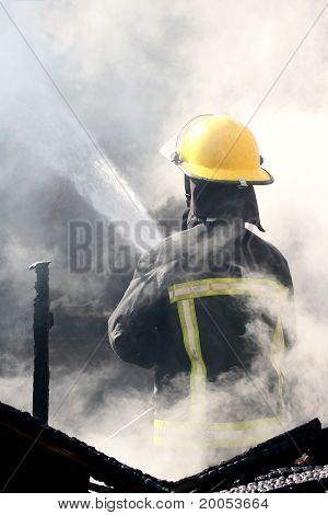 Fireman Putting Out A House Fire