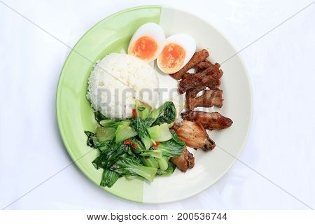 Stir Fried Vegetables, Hard-boiled Egg, Fried Pork And Fried Chicken Wings With Thai Jasmine Rice On