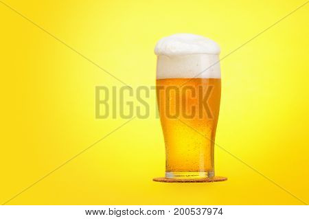 Pints of beer on yellow background copyspace. Oktoberfest design
