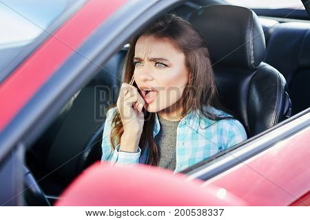 Annoyed Woman Talk On Phone Inside Car