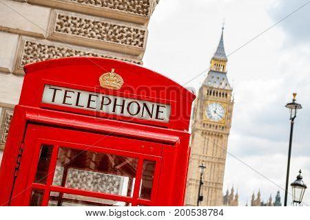Red telephone box near Big Ben. London England