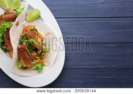 Delicious fish tacos on dark blue background