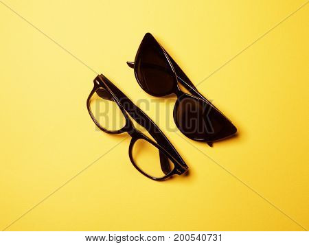 Flat Lay Fashion Set: Two Sunglasses On Pastel Backgrounds
