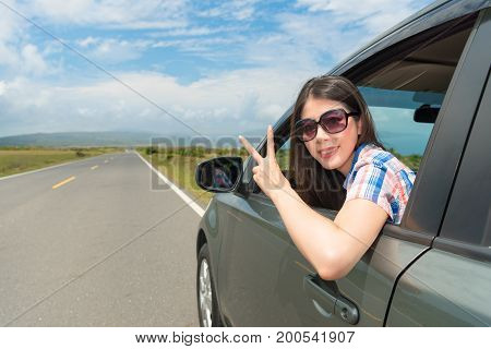 Female Student Drive Stopping At Village Roadside
