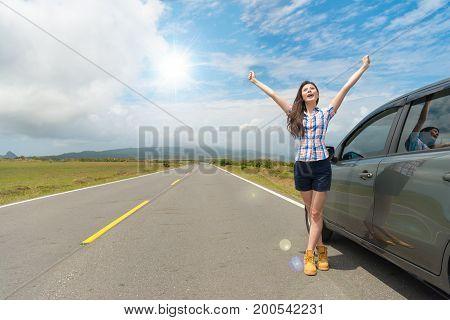 Smiling Beautiful Woman Standing On Asphalt Road