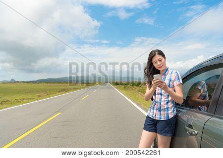 Smiling Female Tourist Using Mobile Smartphone