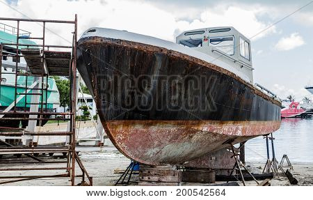 Black and White Rusty Hull in Dry Dock