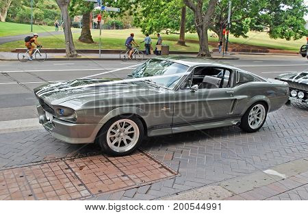 Side view of a classic silver car rented as a part of wedding cortege. This is Shelby 1967 Mustang GT500 model