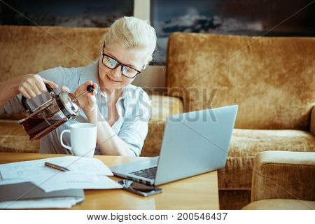 A Woman In Normal Clothes Working At Home. Startup Of The Project.