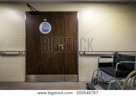 Entrance to the hospital room with wheelchair. Clinic interior.