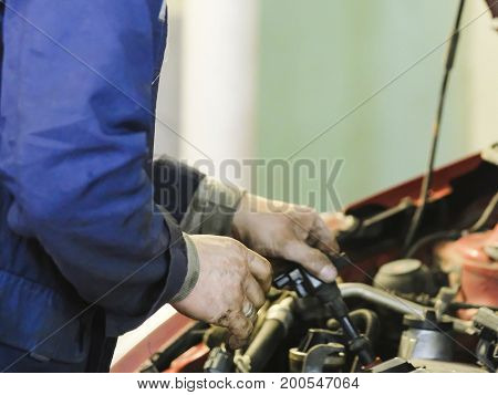 Worker repairs a car in a car repair station