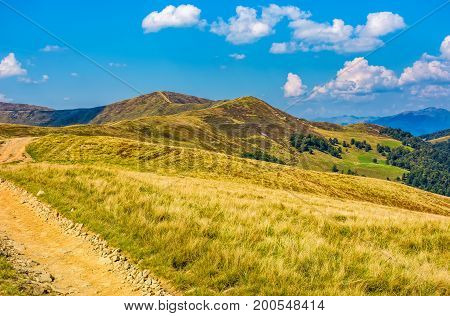 Dirt Road Through Alpine Hills Of Mountain Ridge