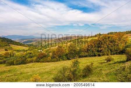 gorgeous countryside with village in valley. spectacular early autumn scenery in mountains