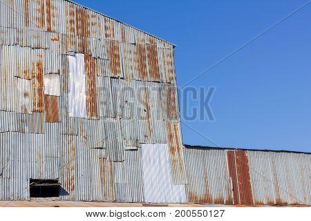 closeup old mill made of rusty galvanized iron