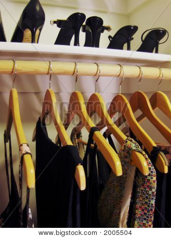 Evening Dresses And High Heels In Closet