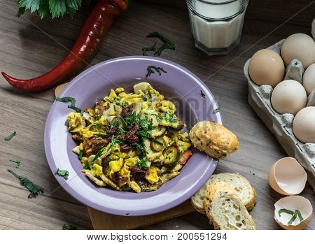 Scrambled egg with dried tomatoes and home baked goods