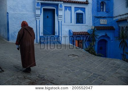 Man In Chefchaouen, The Blue City In The Morocco.