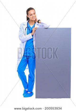 A female doctor with a blank billboard. Woman doctor
