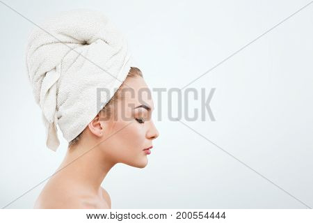 Cute Girl With Naked Shoulders And White Towel On Hair