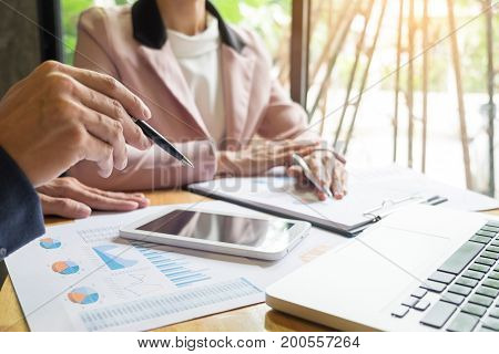 Image Of Two Young Businessmen Partners Looking At Business Document In Touchpad At Meeting Office