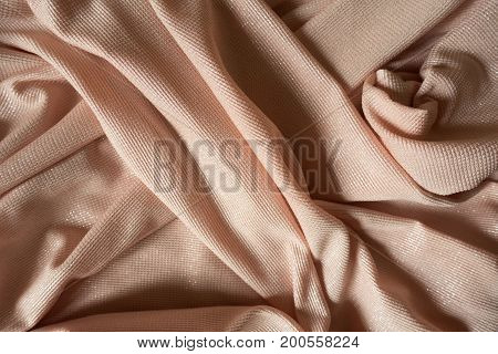 Draped Shiny Peach Colored Plain Polyester Fabric