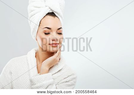 Young Girl With Dark Hair Wearing Bath Robe And Towel